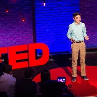Ashton Cofer presents on the TED stage