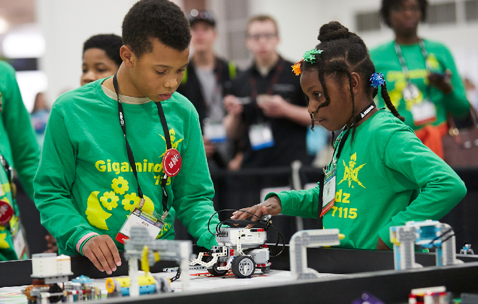 FIRST LEGO League students programming robot